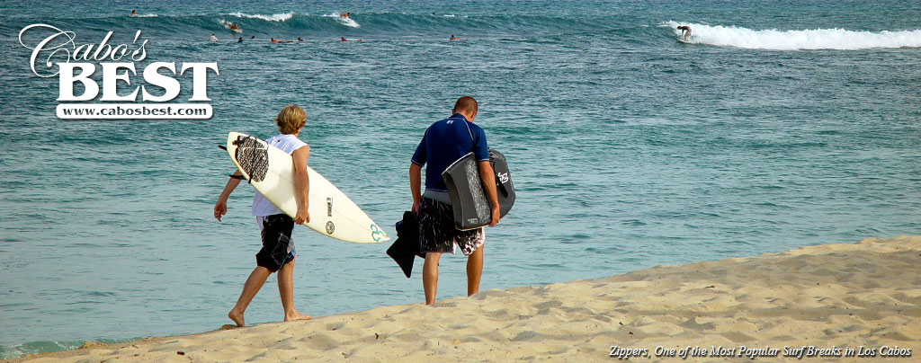 Surfers make their way to Zipper's surf break in San Jose del Cabo