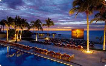 Outdoor theater screens movies and entertainment at Dreams Los Cabos