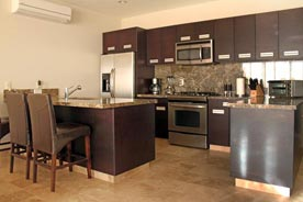 Fully equipped kitchens are featured at Cascasdas de Pedregal vacation rental condos